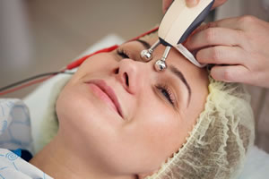Woman having microcurrent treatment done