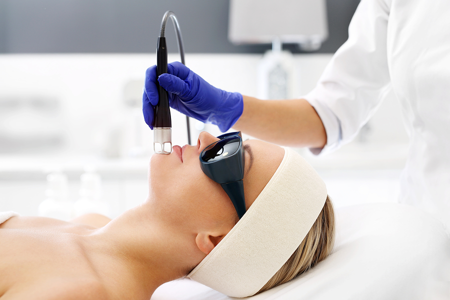 Laser treatment for the face. A woman in a beauty salon during a laser treatment.