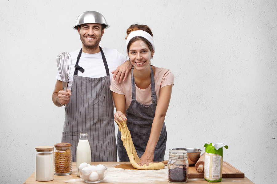 Self-Care as a Pair in Practice: A Couple baking or cooking in their kitchen.