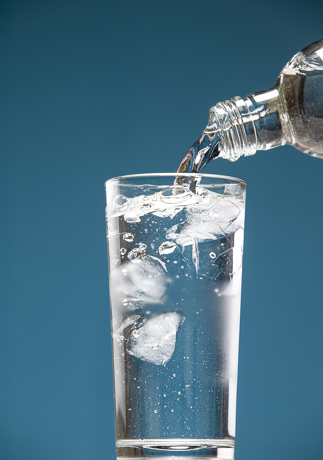 Better When Wet - Just Add Water. A Misted Glass Of Clean Cold Water With Ice And A Bottle
